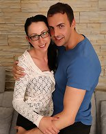 Specky milf in pantyhose gives a guy mature lesson