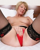 Steamy British wife playing toy in bed