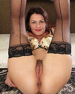 Hairy mature babe Ava Austin wearing only stockings.y